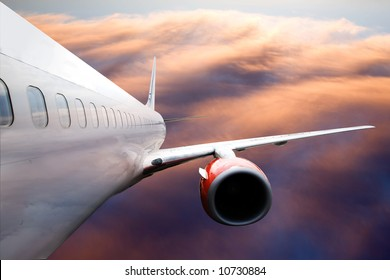 An airplane accending over a dramatic cloudscape.