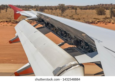 Airplane activates ground spoilers as it lands at the Ayers Rock airport in Australia