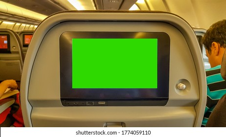 Airplane Aeroplane seat with Green screen cut out  in TV entertainment system