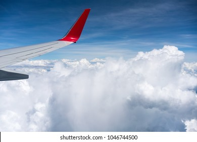 airplane airfoil above the clouds, airline traveling