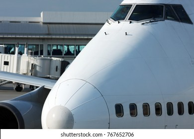 Airplane at an airport gate being serviced in preparation for boarding