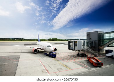 An airplane at the airport on the tarmac