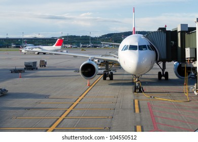 Airplane at an airport with passenger gangway
