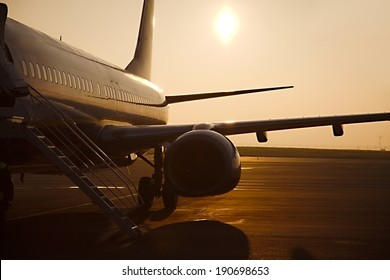 Airplane at an airport at sunrise