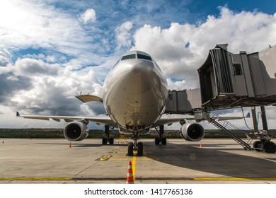 Airplane at the airport terminal.Teletrap to the plane. Passenger aircraft. Preparing aircraft for flight.