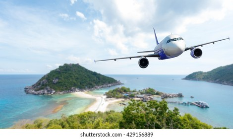Airplane with background of beautiful ocean and island, Koh Nang Yuan in Thailand, exploration conceptual