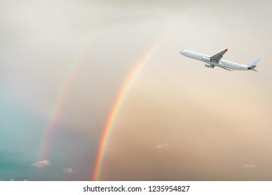 Airplane and beautiful rainbow in the sky