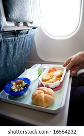 An airplane chicken and potatoes meal
