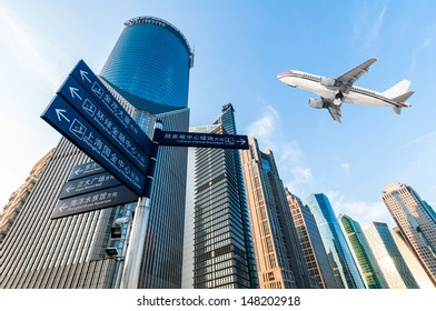 the airplane with the city scene background in Shanghai China