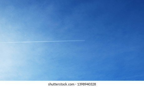 Airplane contrail in the sky