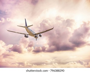 Airplane in the dark cloud sky flight travel transport airline background concept.