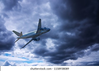 Airplane with dramatic sky, flying at bad weather with dark clouds
