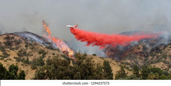 Airplane Drops Fire Retardant on Wildfire