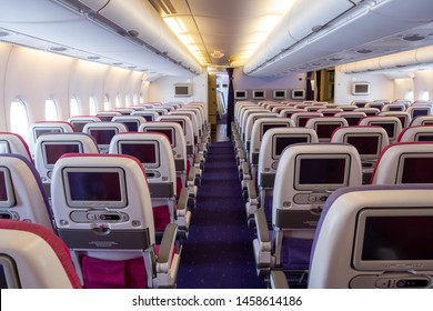 Airplane economy class seat of aircraft cabin interior when fly