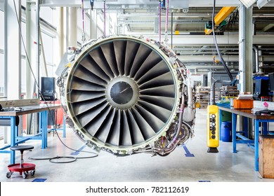 An airplane engine during maintenance in a warehouse