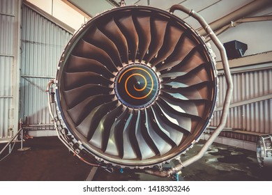 Airplane engine maintenance in airport hangar. Closeup view