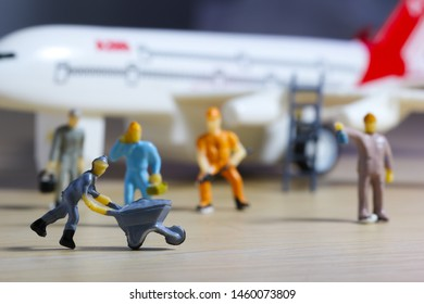 Airplane engineer, airport worker, aircraft people working in fixing, repairing the runway and checking the airplane. Many level of miniature company employee and employer figure as flight concept