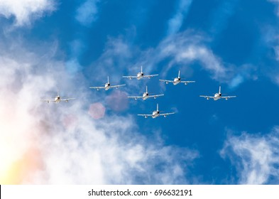 Airplane fighter jets smoke the background of sky clouds