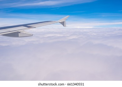 The airplane flew above the Altostratus cloud formation.