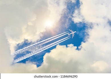 Airplane flies high in the sky, a journey through the clouds and a sunny glare