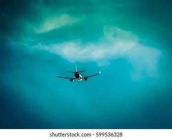 Airplane flies into the dramatic stormy clouds. Bad conditions for flight. Dangerous and risky aircraft transportation.