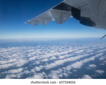 airplane flight above clouds