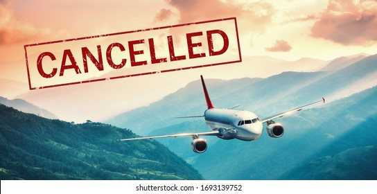 Airplane and flight cancellation. Canceled flights in Europe, Asia and USA airports. Travel cancelled. Pandemic of coronavirus. Fying passenger aircraft over the mountains at sunset and text. Covid-19