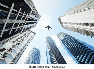 Airplane fly above buildings