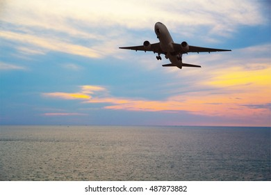 Airplane fly above sea at sunset - Travel Concept