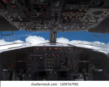 Airplane is flying above white clouds on blue sky ahead view from pilot's cabin - Shutterstock ID 1509767981