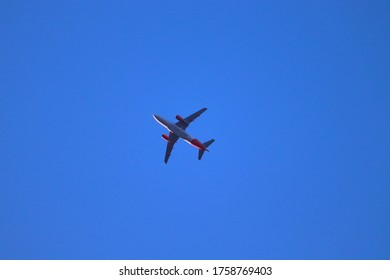 Airplane flying in the air captured from low angle view