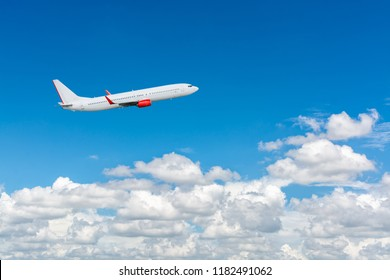 Airplane flying in the blue sky with cloud as the scene