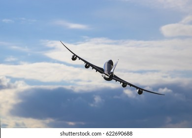 Airplane flying in the cloudy sky. Turn right. Boeing 747-8f.