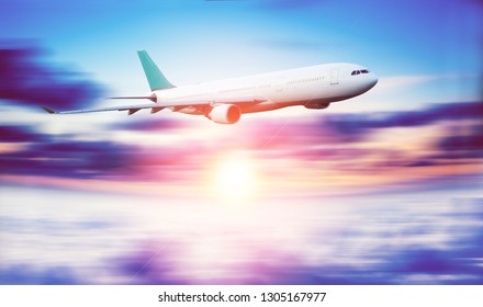 Airplane flying fast above the clouds. Plane and travel  background