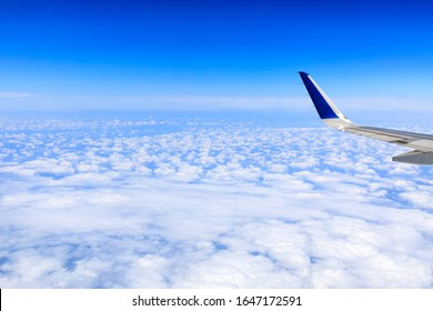 Airplane flying at high altitude and beautiful high-altitude clouds in spring