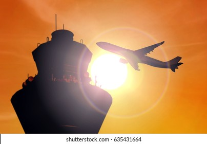 Airplane flying near airport control tower during sunset