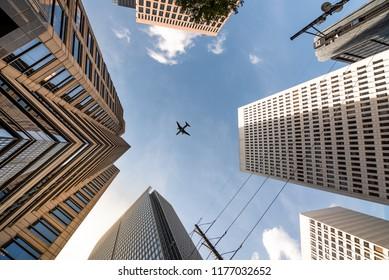 Airplane flying on top of Skycrapers in Midtown Atlanta