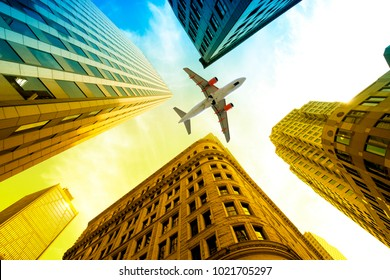 Airplane Flying over buildings in Boston, Massachusetts, USA,