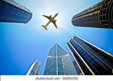 Airplane Flying over buildings in Chicago, USA