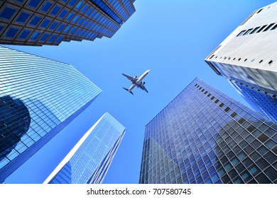 Airplane Flying over buildings in Seoul, KOREA
