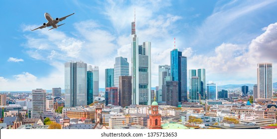 Airplane flying over business skyline of Frankfurt am Main, Germany - financial capital of the european union