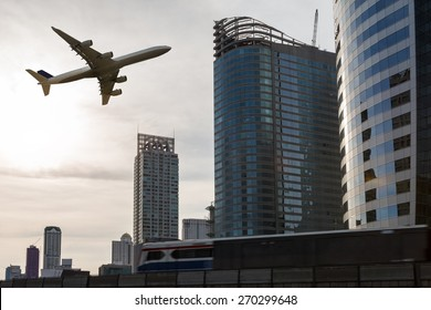airplane flying over city with sky train, Transportation concept