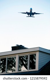 Airplane flying over a residential area, (Zwanenburg), the Netherlands