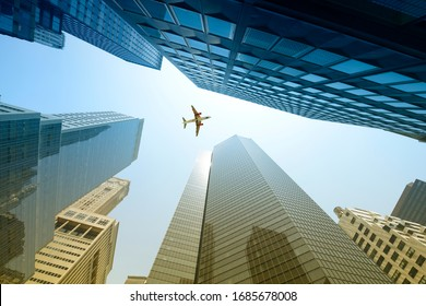Airplane flying over skyscrapers, Manhattan, New York City