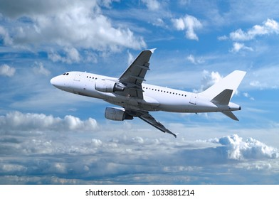 Airplane flying in the sky, travel background with commercial flying airplane with blank livery