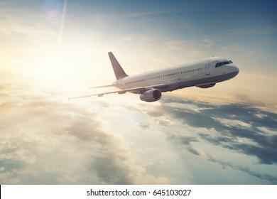 Airplane flying at sunrise