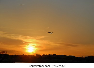Airplane Flying and the Sunset Horizon