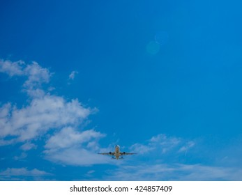 airplane flying, taking off on sunny day