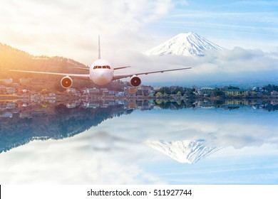 Airplane frying over the Snow Mountain Fuji background