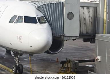 An airplane, with the gangway attached is ready for boarding.